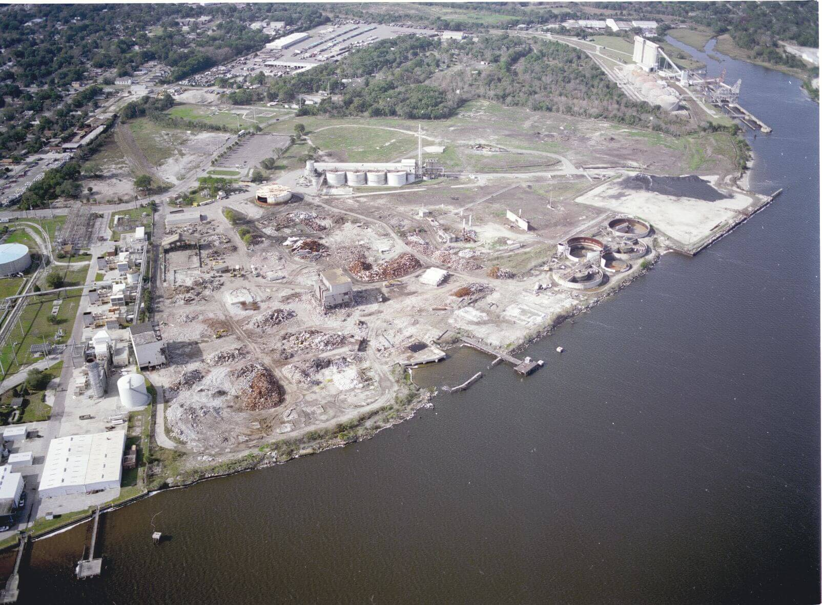 "<h2>Case Study #1 &#8211; Whole Take of Industrial Property with Deep Water Port Access</h2> <p>A municipal port authority with the power of eminent domain initiated ""slow-take"" proceedings to acquire an 60+ acre industrial property with deep water access for the purpose of construction a port terminal to be owned by the port authority and leased to a private import company. The owner of the property purchased the waterfront property with the intent to redevelop the former plant and construct a bulk terminal. The property had many unique characteristics including an abandoned railroad line, industrial buildings and a small office building. Additionally, the property contained a landfill used by the former industrial owner and was encumbered by some contamination. The owner purchased the property for $8 million and assumed all responsibility for the environmental clean-up.</p> <p>In advance of filing the condemnation suit, the port authority offered the owner $14 million to purchase the property. However, the port required the owner to remain liable for the environmental clean-up. The owner refused the port&#8217;s offer and suit was filed. Following a two-week jury trial in which numerous experts testified for both sides concerning the valuation of the industrial fixtures on the site, the cost to cure the environmental issues, the likelihood of the owner obtaining the necessary permits to construct port infrastructure and connect the rail line, as well as the overall value of the property, the jury returned a verdict awarding $76 million in just compensation for the acquisition of the property. Because the port authority used the &#8220;slow-take&#8221; eminent domain power, it was afforded the opportunity to decide whether it wanted to move forward with the acquisition and pay the amount the jury determined to be just compensation or whether it would abandon the condemnation. The port authority decided to abandon the taking remaining liable for the owners&#8217; attorneys fees and costs determined by the court to be in excess of $10 million.</p>"