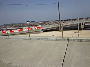 """The view from the Murphy property in the """"after condition"""" as construction was ongoing on the harbor (background) and access bridge (foreground)."""