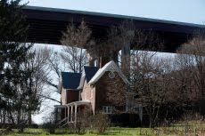 Left: The Jennings Family farm house, built in 1810, sits near the banks of the New River and is nestled under VDOT's I-77 overpass that spans the New River in Max Meadows, Virginia. It's hard to imagine that the bridge at one time did not exist and that this family home once enjoyed peaceful and private times without the noise and debris of passing interstate traffic.