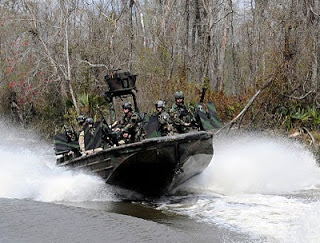 Photo credit: U.S. Navy Official U.S. Navy file photo of Special Warfare Combatant- craft Crewmen assigned to Special Boat Team (SBT) 22.